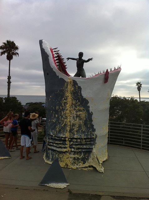 "The infamous ""Cardiff Kook"" statue gets munched by a giant, paper mache shark in Cardiff By The Sea, California. Photo: Liam Ferguson"