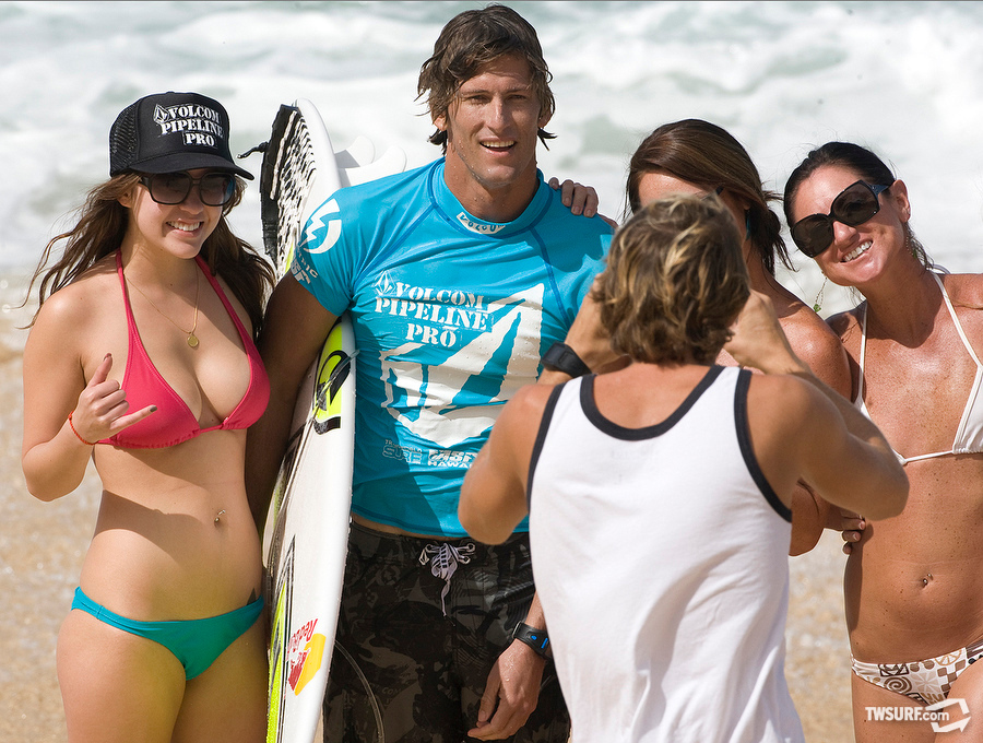 #9. Bruce Irons is always a crowd favorite and when busty girls go running down the beach seeking a photo with him we all win. Photo: Bielmann/SPL