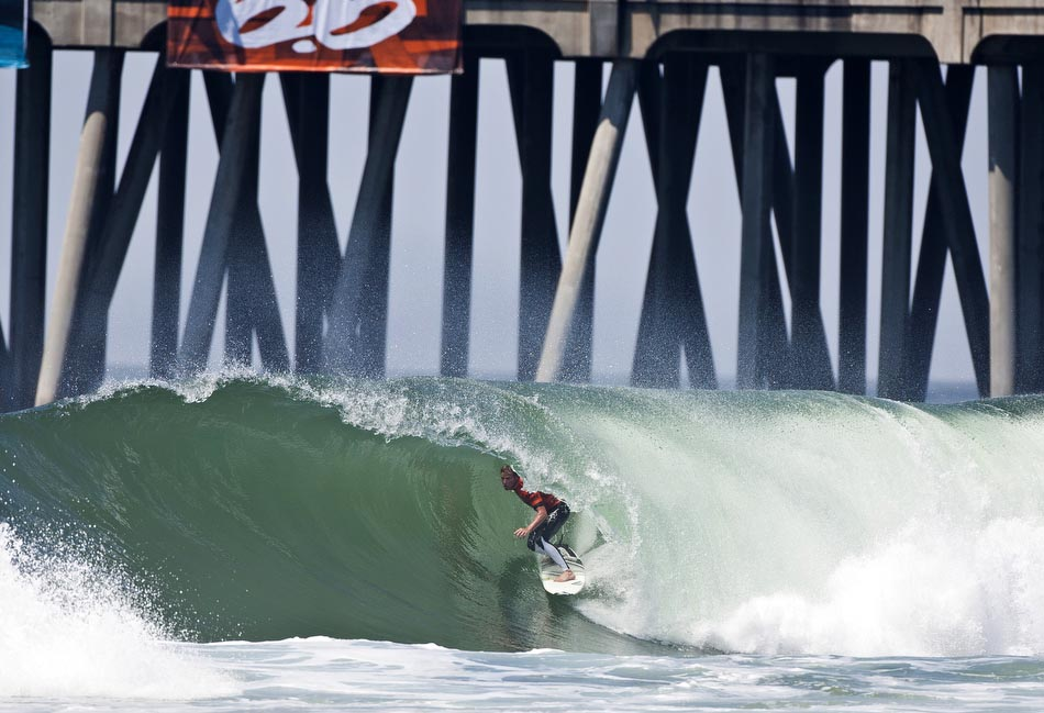 "Normally equated with crummy surf and more ""Huntington Hops"" than tube rides, this year, the US Open was once again blessed with excellent surf and light winds the entire event. Taj Burrow. Photo: Checkwood"